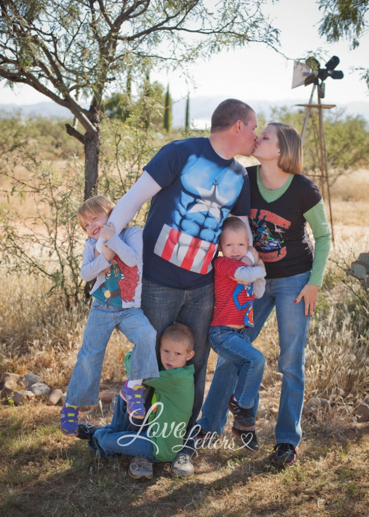 superhero family captain america strong daddy kiss strong man big muscles family pictures Christmas time
